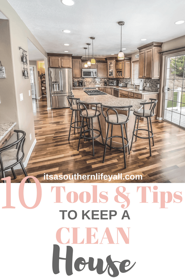 Spotless kitchen with island and wood floors with text overlay - Stop Using Alt Tags for Pinterest Pin Descriptions