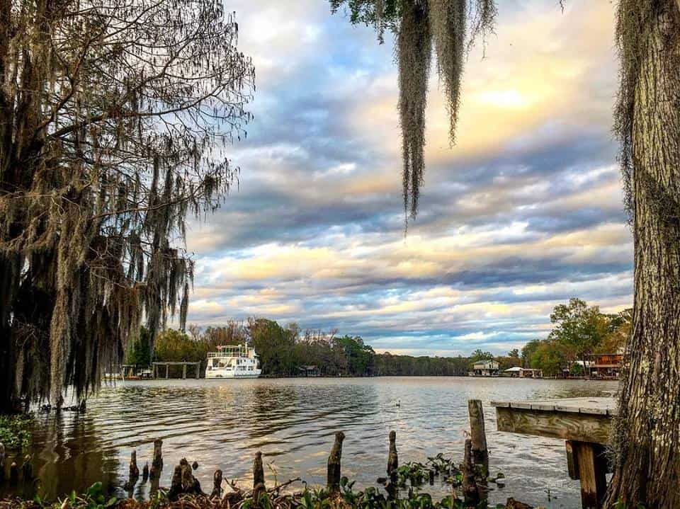Louisiana swamp scene with house boats and beautiful sky.