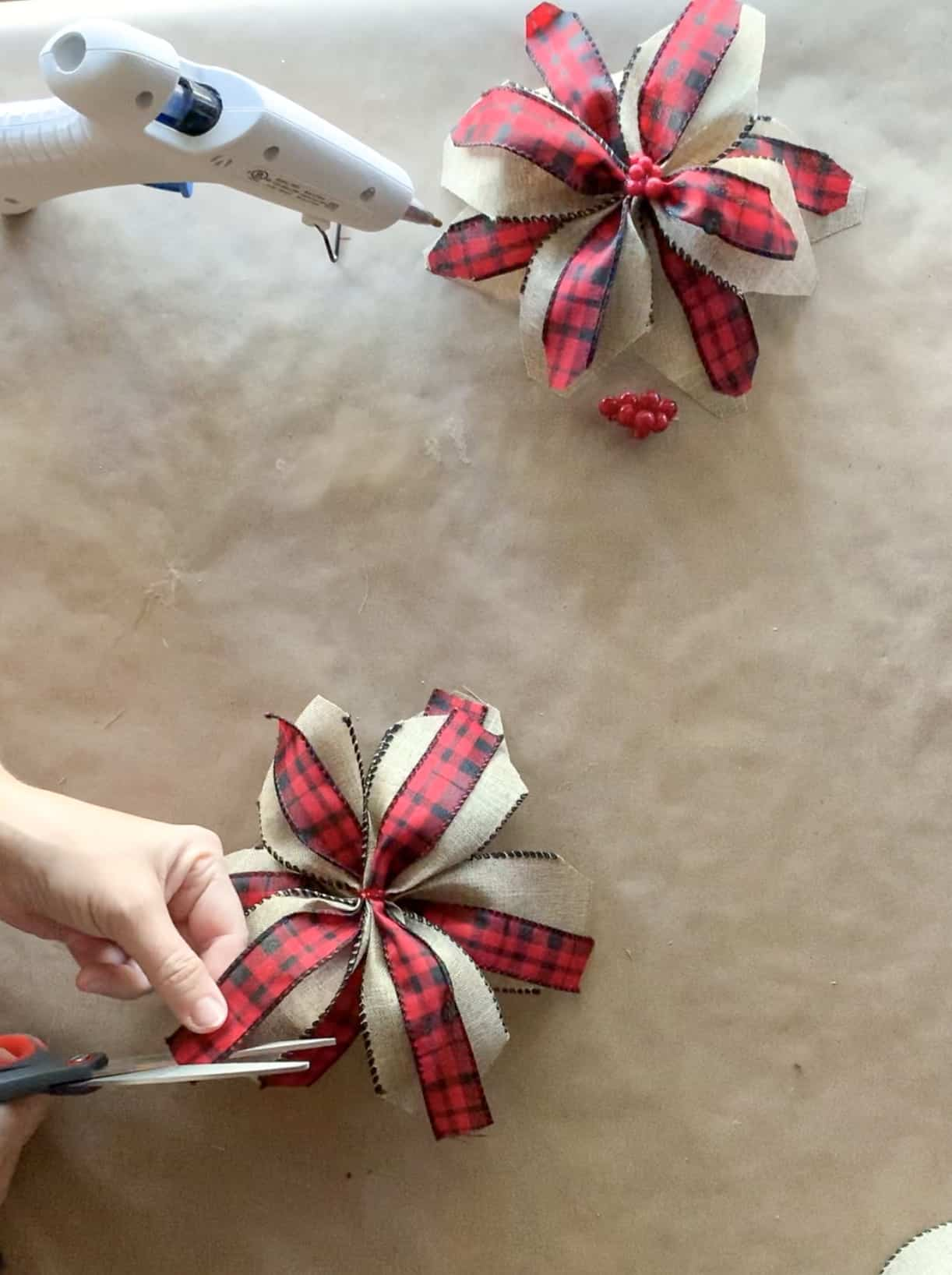 Cutting optional accent ribbon ends.