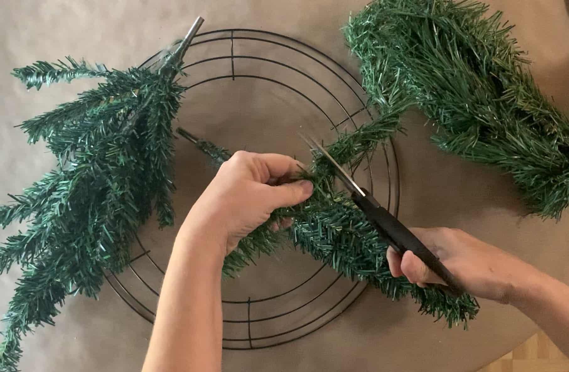 Cutting wired garland.