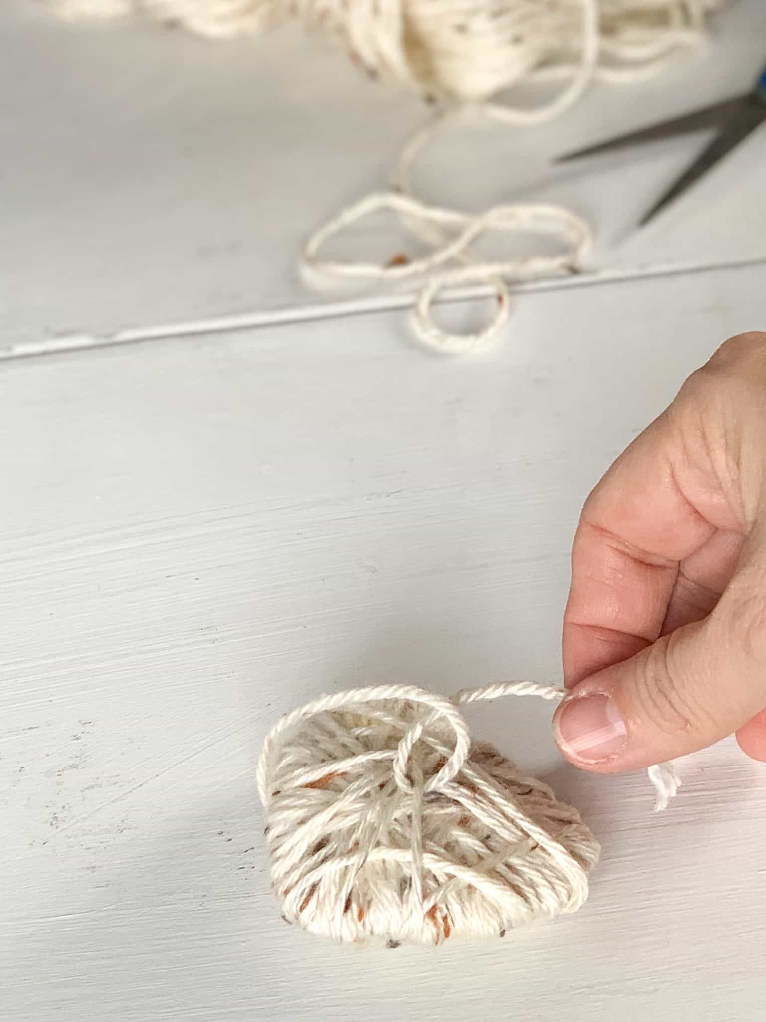 Cut end of yarn and secure by making a knot.