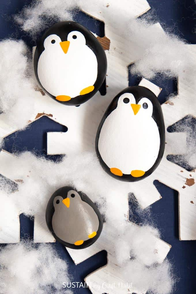 Painted penguin rocks kid's craft.